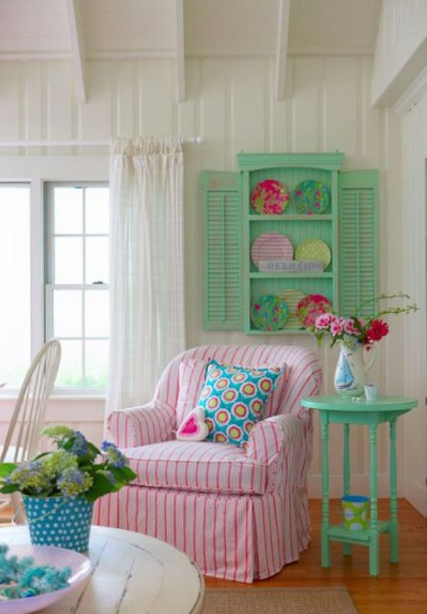 Shabby-Chic-living-room-interior-design-cozy-armchair-white-pink-stipes-green-side-table-wall-shelves