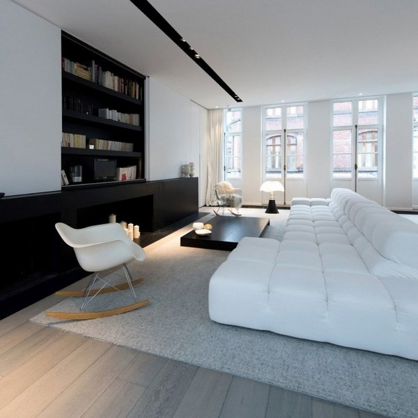 black-and-white-living-room-interior-design-modular-couch-gray-carpet-black-fireplace