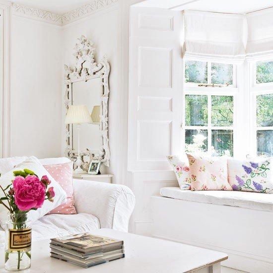 elegant-romantic-shabby-chic-living-room-interior-design-white-sofa-decorative-pillows-framed-mirror
