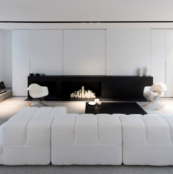 minimalists-living-room-design-black-and-white-interior-white-modular-couch-modern-fireplace