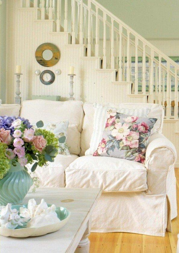 romantic-shabby-chic-living-room-design-white-sofa-wood-floor-decorative-pillows-e1440157312468