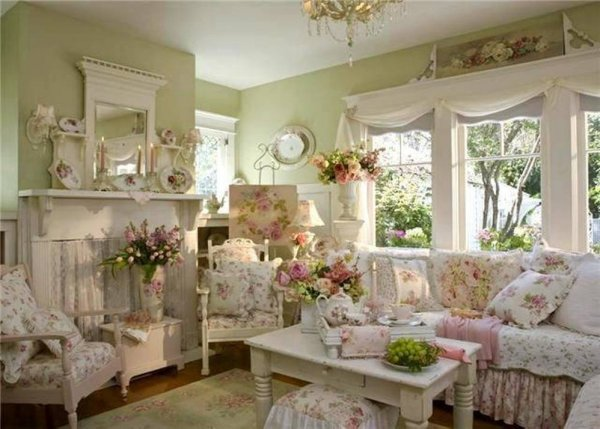 shabby-chic-style-living-room-with-sage-green-wall-and-floral-covers-and-vases-and-vintage-coffee-table-and-mirror-over-mantel másolata