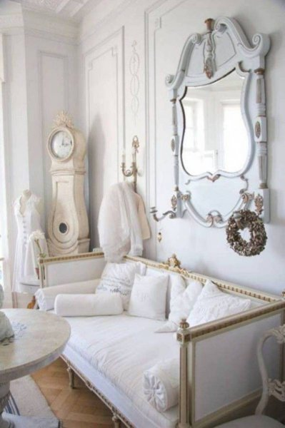 shabby-chic-style-living-room-with-vintage-clock-and-mirror-and-round-table-and-adorable-seating-with-pillows