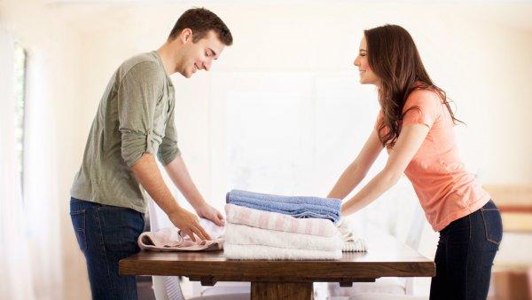 man-woman-folding-clothes